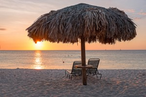 a picture of a cabana and beautiful sunset at boca catalina beach aruba