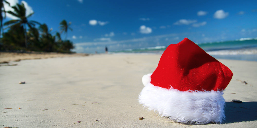 a picture of Santa Claus hat on Aruba beach during Christmas in Aruba