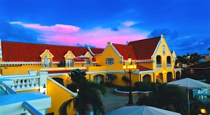 a picture of the amsterdam manor beach resort at sunset