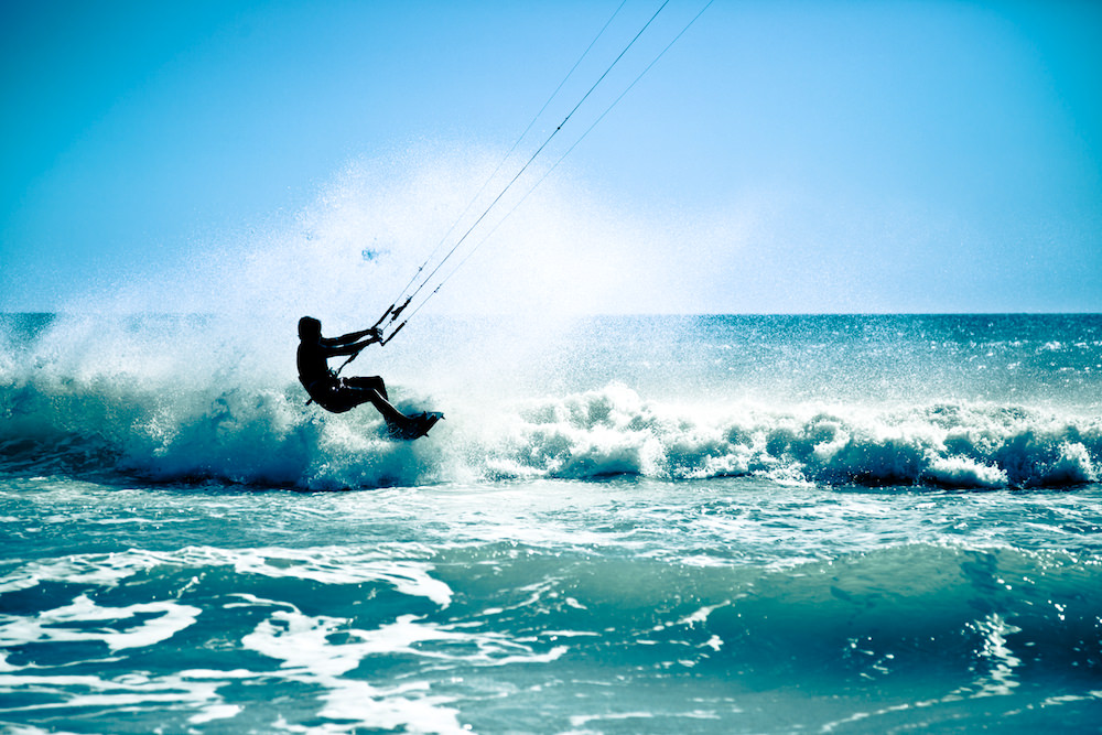 a picture of someone kitesurfing in aruba