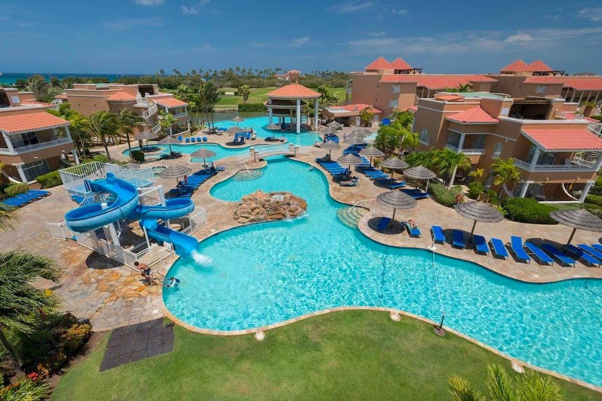 The outdoor pool and waterslide at the All Inclusive Divi Village Golf and Beach Resort Aruba