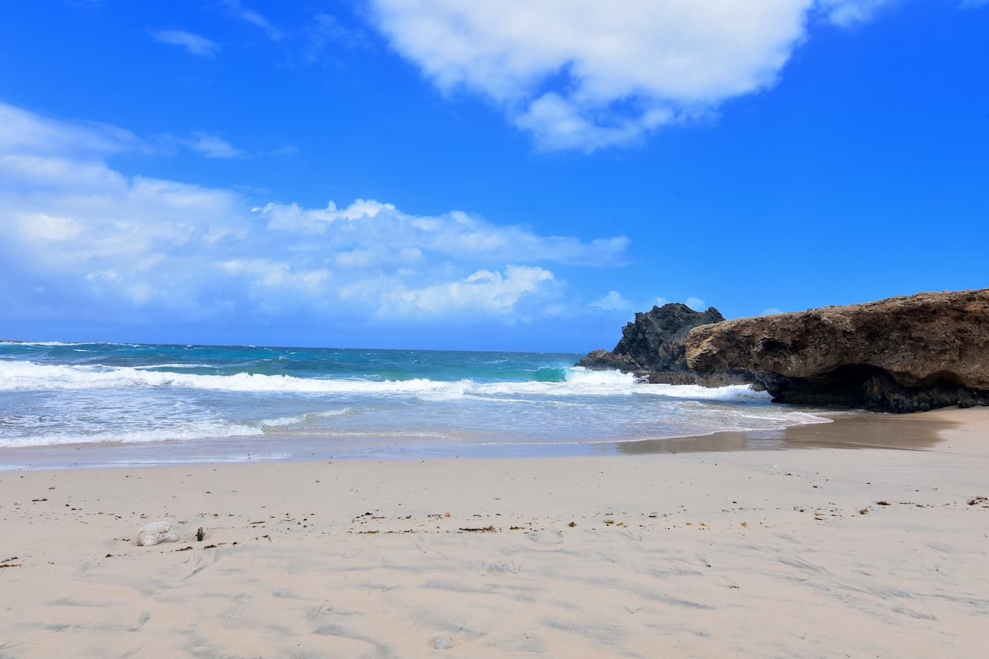 Andicuri Beach, Aruba. It's a natural beauty, but can be wild! Soft sand, a few rocks and beautiful water. Not to be missed!